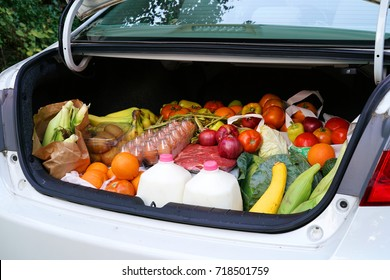 open car trunk full of fresh food from grocery store