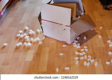 Open cardboard box with peices of styrofoam around