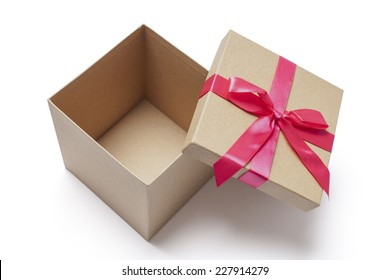 Open carton gift box with red ribbons photographed from the top isolated on white