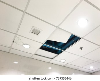 Open ceiling panels in roof office for repair drain pipes water leaking.
