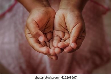 Open children hand begging for help.