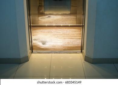 Open chrome metal office building elevator doors