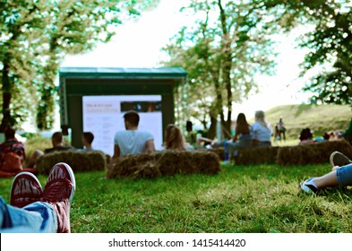 Open cinema in the park of Kalemegdan fortress in Belgrade,Serbia.Belgrade Manifest on May 25, 2019.People enjoy the movie while laying on the straw pillows and green grass