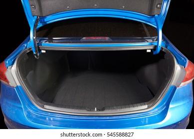 open clean modern blue car trunk close up