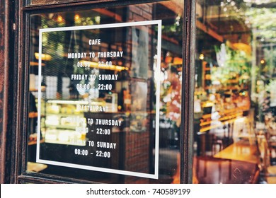 open and close time of a cozy retro cafe on weekdays and weekends at a front door
