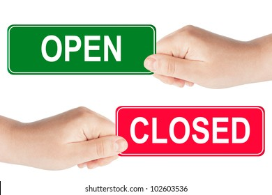 Open and closed traffic sign in the hand on the white background