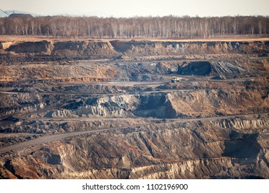 Open coal mine in autumn from high view point
