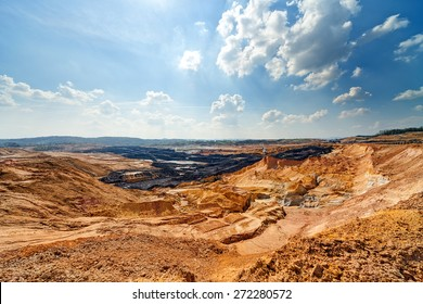 Open coal mining pit with heavy machinery