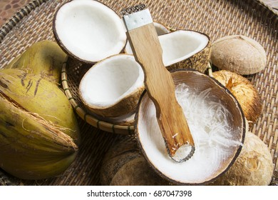 Open coconut with coconut peel on bamboo mat