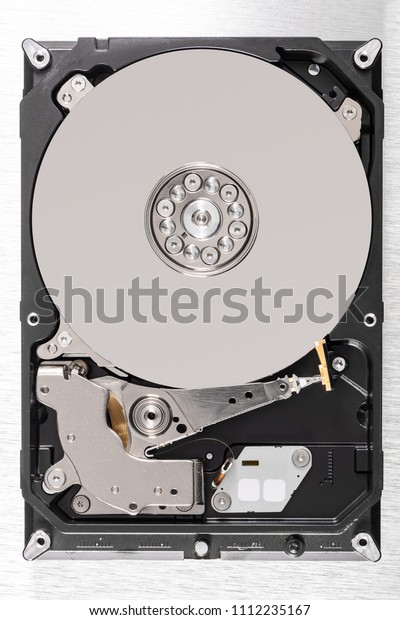 Open computer hard disk drive (HDD) closeup.