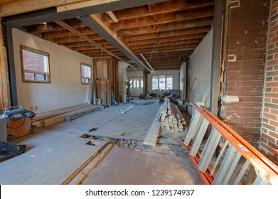 Open concept renovation at residential house in Toronto, Ontario. On the floor are visible tools and wood supply.