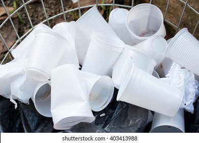 Open container with disposable white plastic cups