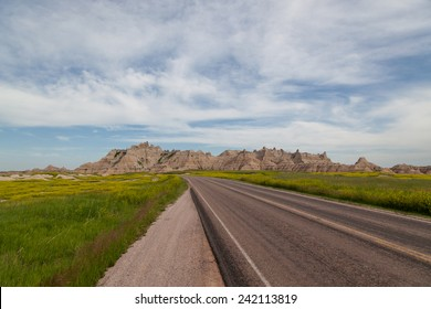 A open country road leads into the awesome mountain formations in Badlands National Park, South Dakota.