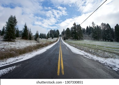 An open country road in winter in Lake Oswego, Oregon.