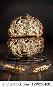 Open crumb basic sourdough bread cut in half