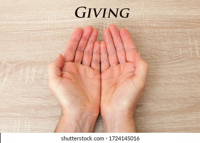 Open cupped hands with the word 'giving'