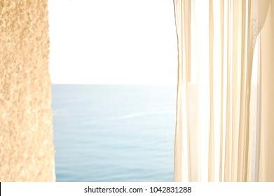 Open Curtain Window overlooking the Ocean