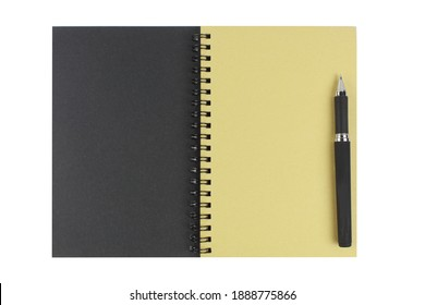 An open diary with a textured surface and yellowed pages and a black ballpoint pen.