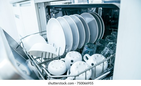 Open dishwasher with clean dishes, close up