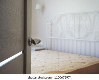 Open door to the bedroom. Blurred focus.