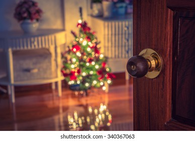 Open door and  Christmas tree in room ( Filtered image processed vintage effect. )