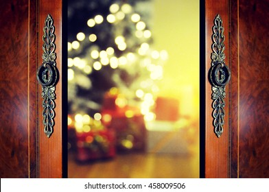 Open door and Christmas tree in room