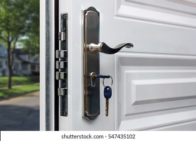 Open Door Of A Family Home. Close Up Of The Lock With Your Keys