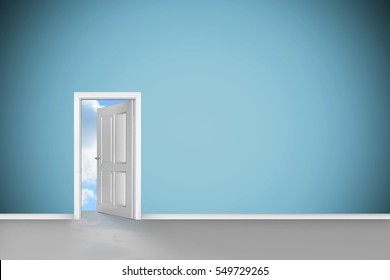 Open door on green wall against blue sky with white clouds