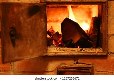 open door of the oven - a fireplace in the rural house, fire in the furnace