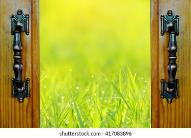 open door over field of green grass with morning light nature background,