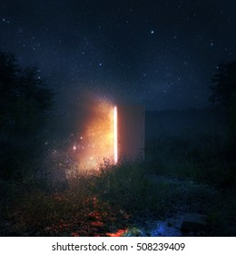 An open door in a pasture at night with glowing lights