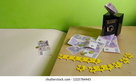 open door of safe vault in bank with money of client flying away, financial concept of banking fraud or swindle posing question about trust of financial institutions (banknotes from Czech Republic,)