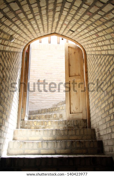 Open door and staircase inside building