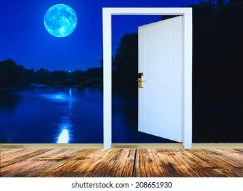 open door view night landscape with the big moon