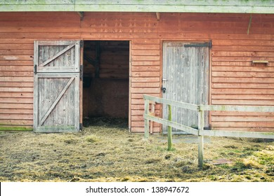 Open door in a wooden barn building