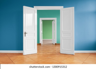 open doors in empty apartment with colored walls