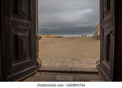 Open doors leading to outdoor view with grey skies