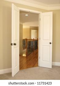Open Double Door to Stairwell and hard wood floors