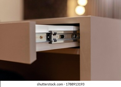 Open drawer showing the metal slides.