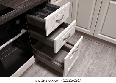 An open drawers in the kitchen table