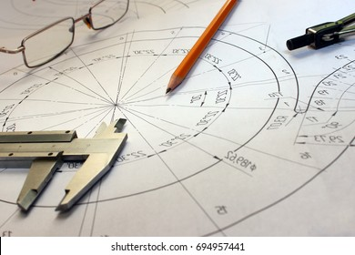 Open drawings with a pencil. Engineering and design. Construction projects. Planning. Measuring instruments