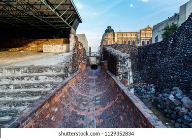 Open duct lined with bricks. It is a water channel built around 1900 that crosses beneath the modern-day street.  It cuts right through the Great Temple, destroying all buildings. Templo Mayor, Mexico