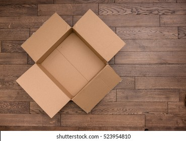 a open empty carton box on wood floor