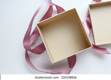 open empty gift box on white table. Colorful Gift box with ribbon bow present on holiday