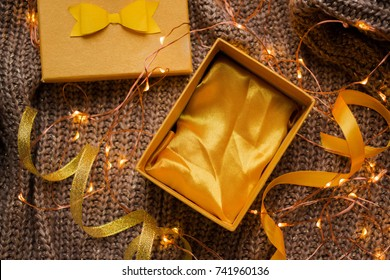 open empty gift box on white table. Colorful Gift box with ribbon bow present on holiday Yellow Gift box with yellow and golden ribbon bow present to New Year or Christmas