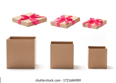 Open empty gift boxes with red ribbons isolated on white