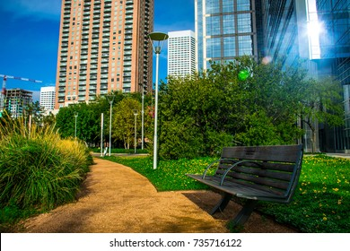 Open Empty Park Bench an Inviting relaxation at Green Discovery Park awaits in Houston ,Texas, USA Downtown Urban Green Environment