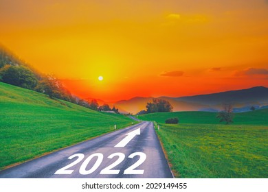 Open empty road path end and new year 2022. Upcoming 2022 goals and leaving behind 2021 year. passing time future, life plan change, work start run line, sunset hope growth begin, go forward concept. - Shutterstock ID 2029149455