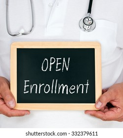 Open Enrollment - doctor holding chalkboard with text