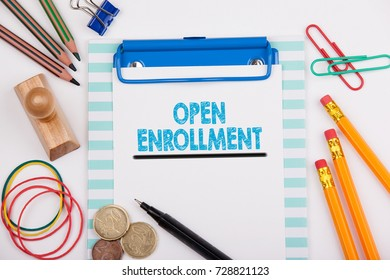 Open Enrollment. White office desk with stationery